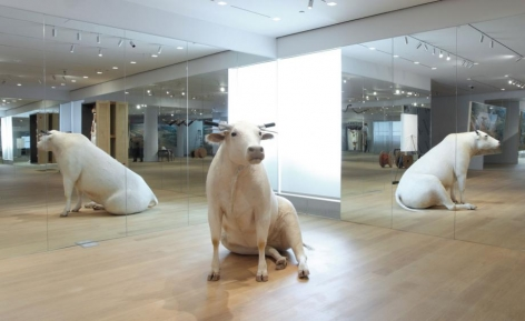 There are animal-centric creations, like the 'Untitled' sitting cow (pictured) with motorcross handles for horns, and the Italian pavilion-inspired 'Turisti' (1997), which sees taxidermy pigeons scattered throughout the gallery