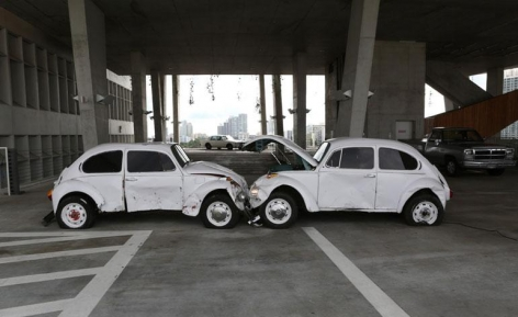'Art History with Passion', by The Bruce High Quality Foundation, 2013, comprises two Volkswagen Beetles set at each other's throats. The familiar forms are anthropomorphised into a bio-mechanical brawl