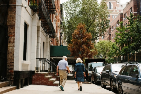 Portrait of Peter and Sally Saul walking on the Upper East Side by Stephanie Nortiz for Artsy.