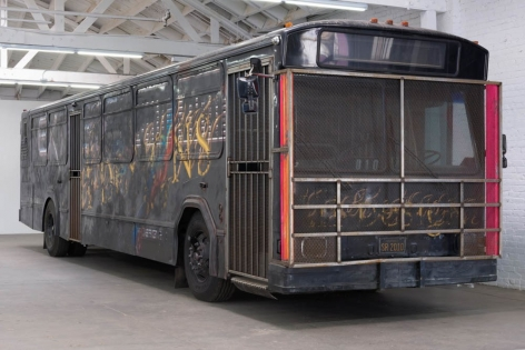 "STERLING RUBY, ""BUS,"" 2010. BUS, STEEL, SPRAY PAINT, STAINLESS STEEL SPHERES, SPEAKERS, SUB-WOOFERS, TIRES, FOAM, VINYL, T5 FLORESCENT LIGHT FIXTURES, T5 BULBS, ELECTRICAL CONDUIT."