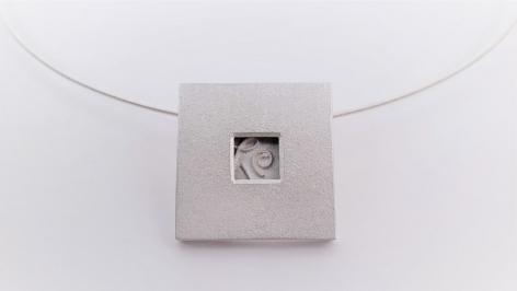 Ann Parkin, Pendant on neck wire - Particle Box #1