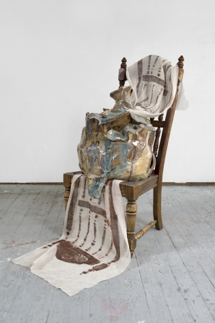 a chair artwork by jessica jackson hutchins with ceramic sculptures on it