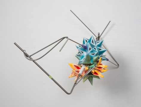 a plastic 3-d printed sculpture by frank stella of geometric, colorful stars