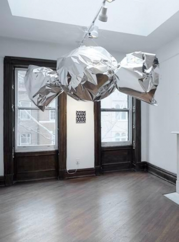 Untitled (candy), 2014, Mirror film, aluminum, motor