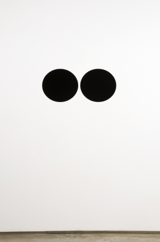 two black dots painted on wall by neil campbell