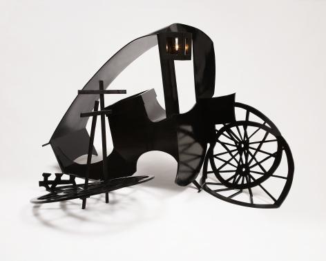 sculpture of a broken black coach by rachel feinstein
