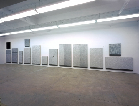 an installation view of donald moffett's painting in a contemporary art gallery in new york city