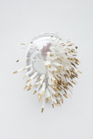 Fencing mask with gold tipped feathers inserted by Allison Janae Hamilton