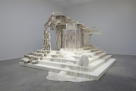 an architectural installation of dripping polymer gypsum by the sculptor Diana Al-Hadid