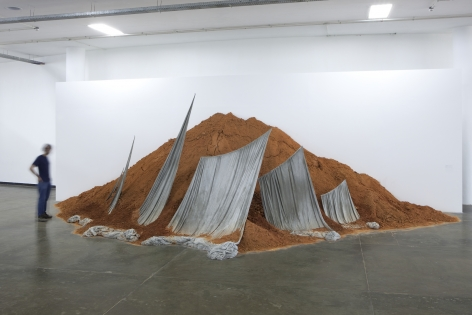 an installation with soil and sails by contemporary artist thiago rocha pitta