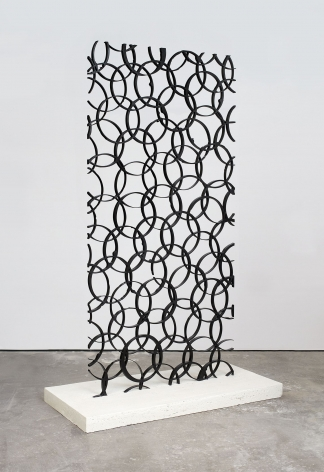 anthony pearson's steel sculpture of overlapping circles shown at an angle