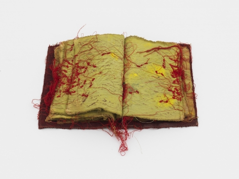 a fabric book by artist Maria Lai for sale at a new york city gallery