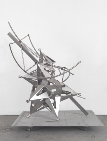 a deconstructed star sculpture of metal by Frank Stella in a chelsea contemporary art gallery
