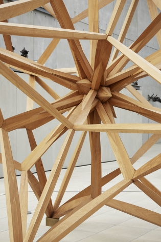 A detail of a wooden star made out of teak by frank stella