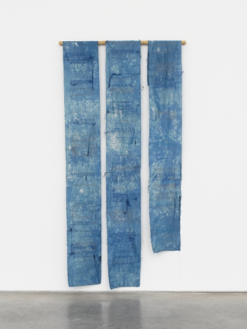 three hanging fabric panels in blue dye and embroidered by maria lai