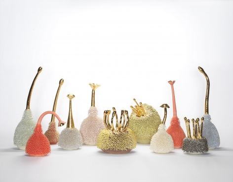 Group of multicolored porcelain sculptures with gold accents by the artists the haas brothers