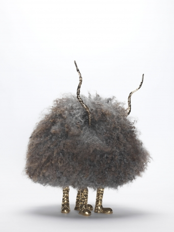 Sculpture made of gotland fur with brass legs and horns by the artists the haas brothers