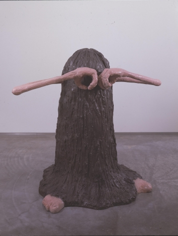 sculpture of a hairy creature with hands covering his eyes