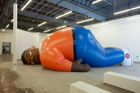 Fat Albert blow-up figure called Laocoon by the artist Sanford Biggers