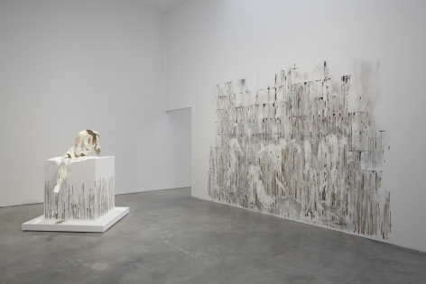 a view of a Chelsea art gallery of Diana Al-Hadid's sculptures and wall panels