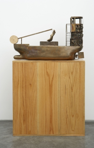 sculpture with boat on wooden pedestal by pentti monkkonen