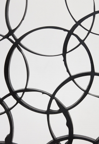 a detail of a geometric steel sculpture by anthony pearson