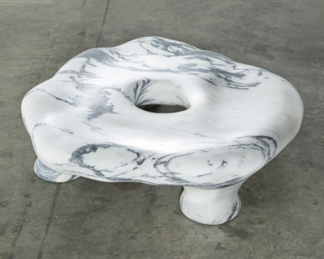 a marble seat by the Haas Brothers- a Pele de Tigre marble sculpture