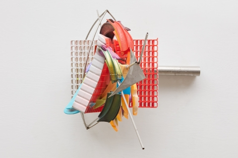 a 3-d printed artwork by frank stella of geometric forms in a nyc gallery