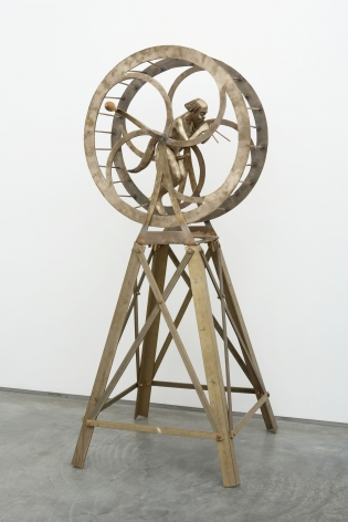 sculpture with satyr in an orb on a tripod by pentti monkkonen