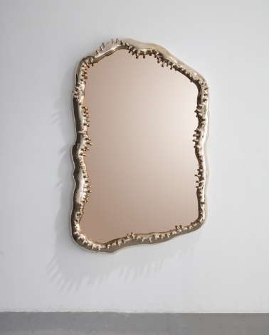 a bronze mirror by Niki and Simon Haas in an exhibition in a Chelsea gallery in NYC