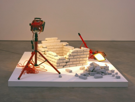installation with bricks and a toppled work lamp by kon trubkovic