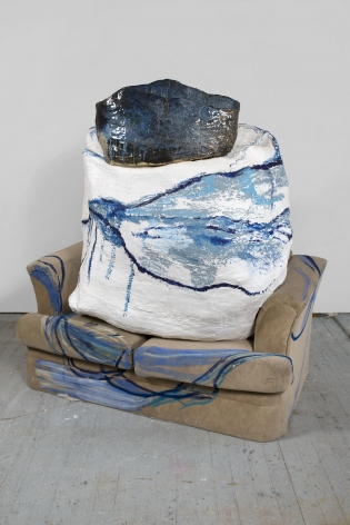 a sofa with a large ceramic on top of it by the ceramicist artist jessica jackson hutchins