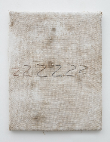 a cream-colored dyed burlap artwork by the minneapolis-based artist jay heikes