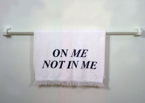 "towel on rack with ""on me not in me"""