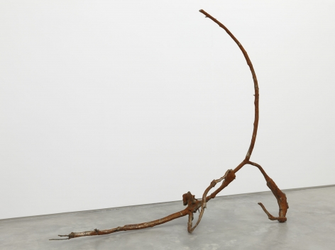 a rusted iron and bronze abstract sculpture by jay heikes exhibited in a nyc gallery