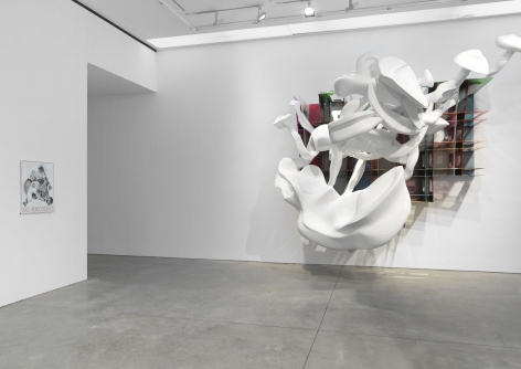 smoke ring sculpture made of steel by Frank Stella exhibited in a New York gallery