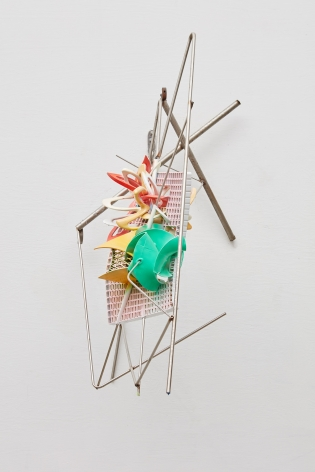 a geometric colorful sculpture by frank Stella for sale in a nyc gallery