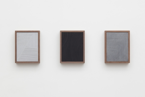 three grey and black paintings in a triptych by anthony pearson