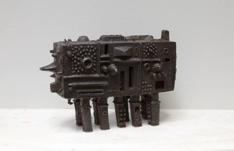 iron sculpture with legs and protrusions by julius smith