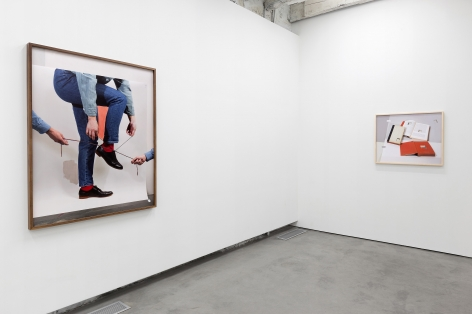 the exhibition in a contemporary art gallery featuring artworks by john houck