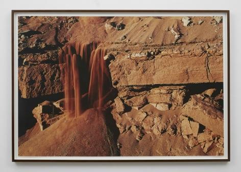 a photograph of sand falling down a landscape by brazilian artist thiago rocha pitta