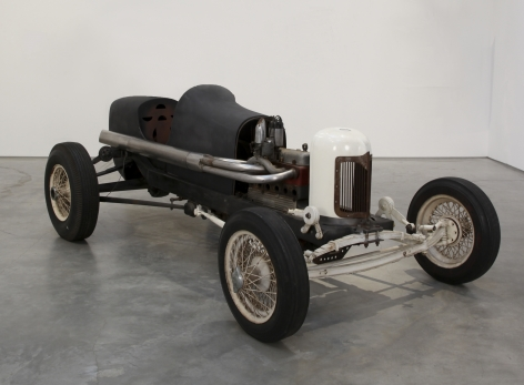 a race car by salvatore scarpitta exhibited in a contemporary art gallery