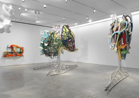 Colorful kinetic sculptures that can rotate and are on steel bases, made by Frank Stella