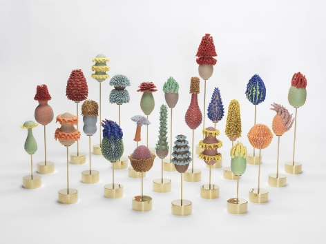 Group of multicolored ceramic egg-shaped sculptures by the artists the haas brothers