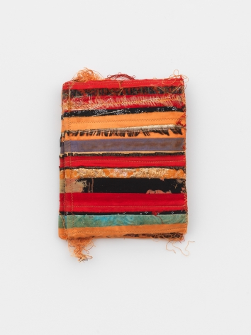 a small fabric book by italian textile artist maria lai