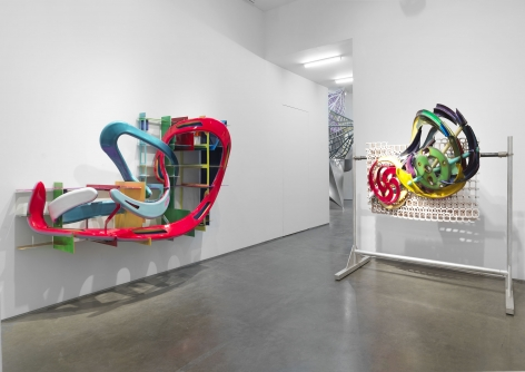 A bent steel sculpture and a 3-d printed sculpture by Frank Stella