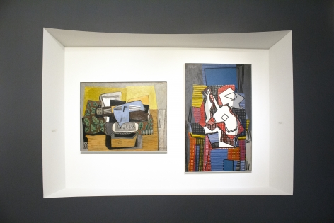 Installation view of The Climax of Cubism, booth 301 at TEFAF Spring 2019. Photography by Studio MDA. This photo features two paintings by Pablo Picasso, on the left, Violon et Journal sur Tapis Vert (le jour)  (Violin and Newspaper on a Green Carpet (daytime))