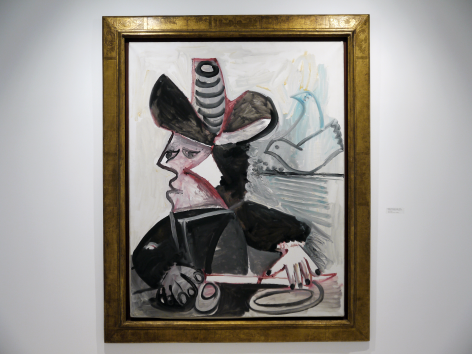 Installation view of Selected Works by 20th Century Masters featuring Pablo Picasso's painting, Mousquetaire aux Oiseaux II, 13 January 1972, 1972, Oil on canvas, 146 x 114 cm. (57 ½ x 44 ⅞ in.) Photography by Bianca Boragi. ©Helly Nahmad Gallery NY.
