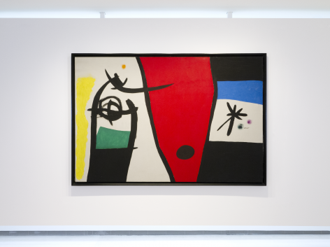 "This is a photo of a large scale painting produced by Joan Miro titled ""Femme à la voix de rossignol dans la nuit"" and produced 1971. It is abstract and the rectangular horizontal canvas is composed of 3 ares each divided by a thick black line. The left side is depicting in a calligraphic brushstoke style executed with thick black line a shape that looks like the top part of a large fish, revealing a head and an eye. Theres a rectangular dark green area under that animal like form on the left of it is an area painting in bright yellow. On the right of that form is the center of the canvas shaped as a wide red cone shape with a large black dot at its bottom. On the right of the canvas, the area is divided in four very wide stripes piled up horizontally, the first stripe is black, the second underneath is a rich blue azure, underneath is the raw canvas not painted with the motif of a large star executed with thick black lines there is two dots on the right of it, one green, one purple. underneath there is a black stripe."
