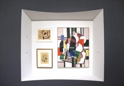 """Installation view of The Climax of Cubism, booth 301 at TEFAF Spring 2019. ©Helly Nahmad Gallery NY. Photography by Studio MDA.  This photo features two drawings by Léger, Composition aux Eléments Mécaniques ( Composition with Mechanical Elements), 1917, the second drawing is Etude pour le Remorqueur (Study for the Tugboat), 1917, the painting on the right is """"Les Femmes a la Toilette"""", 1920."""